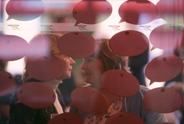 people behind speech bubbles